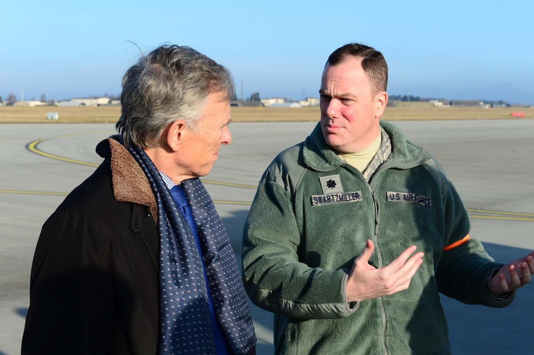 David McKean, left, U.S. Ambassador to Luxembourg, is briefed by Lt. Col. Justin Swartmiller, right, 726th Air Mobility Sqaudron commander, about the purpose and abilities of the unit at Spangdahlem Air Base, Germany, Dec. 20, 2016. This was McKean's first visit to the base as he was briefed by leadership about the Saber Nation mission and different capabilities of the base during his tour. McKean was sworn in as Ambassaor in March 2016. (U.S. Air Force photo by Senior Airman Joshua R. M. Dewberry)