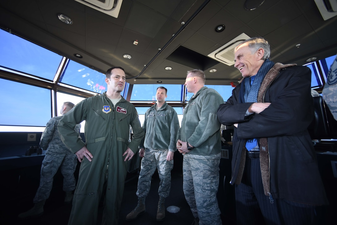 David McKean, right, U.S. Ambassador to Luxembourg, is briefed by Lt. Col. Ryan Nudi, left, 52nd Operations Support Squadron commander, in the air traffic control tower about the unit's mission and impotance at Spangdahlem Air Base, Germany, Dec. 20, 2016. This was McKean's first visit to the base as he was briefed by leadership about the Saber Nation mission and different capabilities of the base during his tour. McKean was sworn in as Ambassaor in March 2016. (U.S. Air Force photo by Senior Airman Joshua R. M. Dewberry)