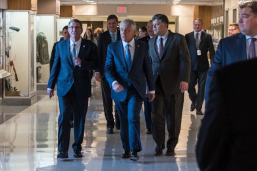 Former Defense Secretary Chuck Hagel, flanked by Defense Secretary Ash Carter and Michael Rhodes, deputy of administration, Office of the Deputy Chief Management Officer, arrive for the opening of a Pentagon exhibit commemorating the 50th anniversary of the Vietnam War, Dec. 20, 2016. DoD photo by Air Force Staff Sgt. Jette Carr