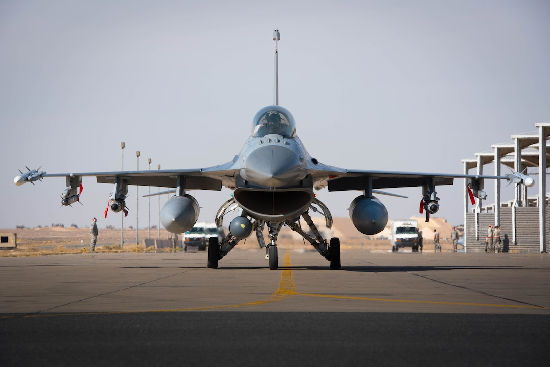 An F-16 Fighting Falcon deployed with the 134th Expeditionary Fighter Squadron taxies for a combat mission from the 407th Air Expeditionary Group, Southwest Asia, Dec. 13, 2016. The unit was able to fly combat operations within 15 hours of arriving at the deployed location.(U.S. Air Force photo/Master Sgt. Benjamin Wilson)(Released)