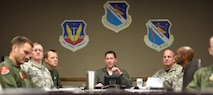 U.S. Air Force Col. Lance Wilkins, 53rd Weapon Evaluations Group commander, listens and responds to Airmen during a PoinT briefing in the 53rd WEG conference room Dec. 16, 2016. The briefing was the first rendition of the units new Power of Innovative Thinking (PoinT) initiative where selected Airmen from different squadrons within the 53rd WEG are presented a problem and have a fiscal quarter to develop plausible solutions. (U.S. Air Force photo by Senior Airman Solomon Cook/Released)