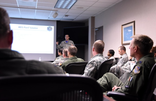 U.S. Air Force Staff Sgt. Cory Hinton, 83rd Fighter Weapons Squadron weapons evaluator, briefs members of the 53rd Weapon Evaluations Squadron leadership during the first meeting of the unit's new Power of Innovative Thinking (PoinT) initiative. The initiative is meant to facilitate a dialog between different squadrons within the 53rd WEG to come up with plausible solutions for problems within the organization. (U.S. Air Force photo by Senior Airman Solomon Cook/Released)