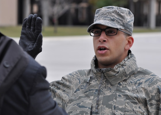 U.S. Air Force Trainee Rachid Karame, 321st Training Squadron, takes his oath of citizenship at the basic military training retreat ceremony at Joint Base San Antonio – Lackland, Texas, Dec. 8, 2016. Trainee Karame became a citizen by joining the Air Force through the Naturalization at Basic Training Initiative. (U.S. Air Force photo by 1st Lieutenant Beau Downey)