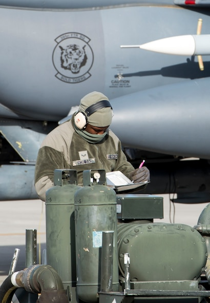 Airman 1st Class Mykel Thomas, 366th Logistics Readiness Squadron's fuels flight, documents gallon amounts from a MH-2 hosecart meter after issuing fuel to an F-15E Strike Eagle during hot pit operations Nov. 16, 2016 at Mountain Home Air Force Base, Idaho. The 366th LRS fuels flight is responsible for safely and efficiently receiving, storing and transferring petroleum, oil and lubricant products in support of the 366th Fighter Wing's mission. (U.S. Air Force photo by 1st Lieutenant Kip Sumner/Released)