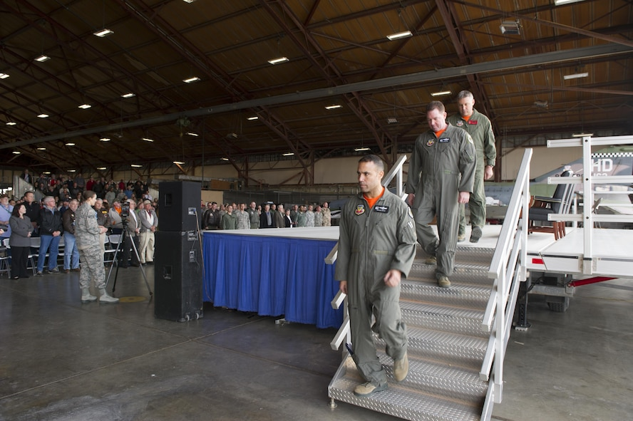 Col. Adrian Spain (bottom), 53rd Wing commander; Col. Lance Wilkins (middle), 53rd Weapons Evaluation Group commander; Lt. Col. Ronald King (top), 82nd Aerial Target Squadron, Det 1 commander, leave the stage after providing their comments during the QF-4 Phinal Phlight ceremony Dec. 21, 2016 at Holloman Air Force Base, N.M. Hundreds of people were in attendance to commemorate the aircraft's retirement, marking the end of the aircraft's 53 years of service to the Air Force. (U.S. Air Force photo by Master Sgt. Matthew McGovern)