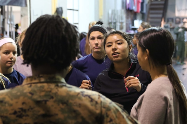 U.S. Marine Corps poolees ask questions about physical fitness to Staff Sgt. Jennifer Landry during Marine Corps Recruiting Station Detroit's all-hands female pool function December 10, 2016, in Troy, Michigan. The purpose of the pool function was to help prepare the poolees both physically and mentally for the challenges of recruit training at Marine Corps Recruit Depot Parris Island, South Carolina. During the function there was a question and answer period where the ladies were able to ask female Marines question about daily life aboard the depot. (U.S. Marine Corps photo by Sgt. J. R. Heins/ Released)