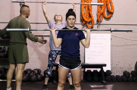 U.S. Marine Corps Poolee Maelym R. Russo performs push presses during a Marine Corps Recruiting Station Detroit's all-hands female pool function December 10, 2016, in Troy, Michigan. Russo a native of Rockwood, Michigan, was recruited out of Recruiting Sub Station Wyandotte's office and is slated to attend Marine Corps Recruit Depot Parris Island, South Carolina, in April 2017. (U.S. Marine Corps photo by Sgt. J. R. Heins/ Released)
