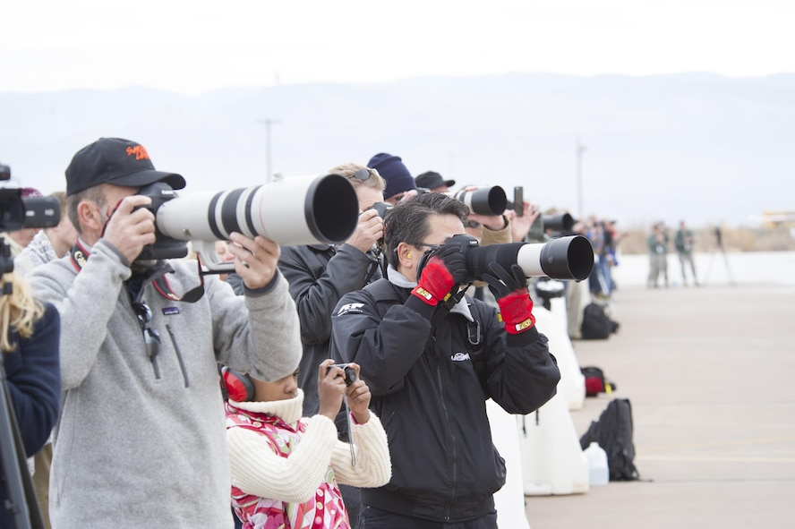Spectators photograph the last flight of the QF-4 Phantom during the QF-4 Phinal Phlight event Dec. 21, 2016 at Holloman Air Force Base, N.M. Hundreds of people were in attendance to commemorate the aircraft's retirement, marking the end of the aircraft's 53 years of service to the Air Force. (U.S. Air Force photo by Master Sgt. Matthew McGovern)