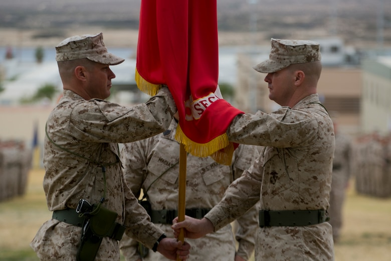 Lt. Col. Christopher T. Steele, outgoing commander and Lt. Col. Jonathan Q. Kenney, oncoming commander, 2nd Battalion, 7th Marine Regiment, exchange the battalion's colors during the units change of command ceremony at Lance Cpl. Torrey L. Gray Field aboard Marine Corps Air Ground Combat Center Twentynine Palms, Calif., Dec. 15, 2016. (Official Marine Corps Photo by Cpl. Julio McGraw/Released)