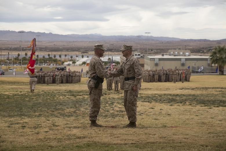Lt. Col. Christopher T. Steele, outgoing commander and Lt. Col. Jonathan Q. Kenney, oncoming commander, 2nd Battalion, 7th Marine Regiment shake hands  during the unit's change of command ceremony at Lance Cpl. Torrey L. Gray Field aboard Marine Corps Air Ground Combat Center Twentynine Palms, Calif., Dec. 15, 2016. (Official Marine Corps Photo by Cpl. Julio McGraw/Released)