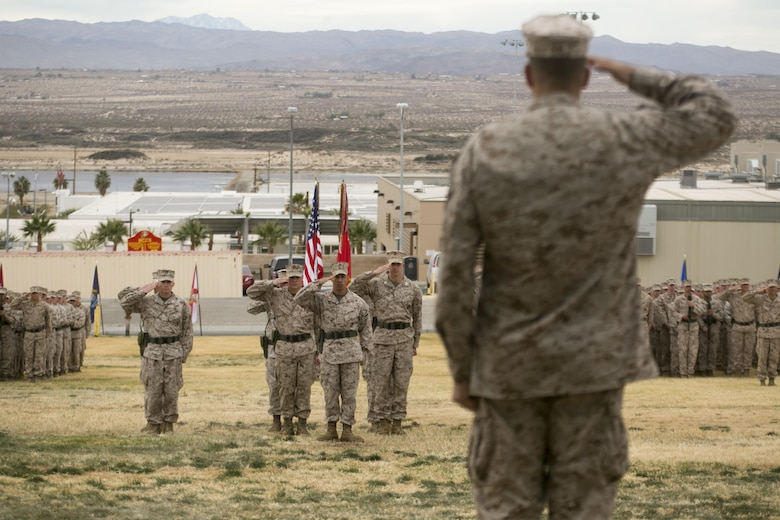 Maj. Gen. Daniel O'Donohue, 1st Marine Division Commanding General, salutes the Marines and sailors of 2nd Battalion, 7th Marine Regiment during the unit's change of command ceremony at Lance Cpl. Torrey L. Gray Field aboard Marine Corps Air Ground Combat Center Twentynine Palms, Calif., Dec. 15, 2016. Lt. Col. Christopher T. Steele relinquished command of 2/7 to Lt. Col Jonathan Q. Kenney. (Official Marine Corps Photo by Cpl. Julio McGraw/Released)
