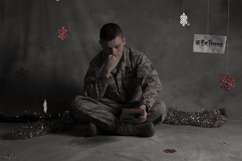 """According to the Dyess Chapel staff, one of the biggest factors contributing to holiday depression is a lack of family or friend contact, especially in Airmen who are unable to return home during the holiday season. Defense officials are encouraging servicemembers to, """"#BeThere"""" for one another this holiday season. (U.S. Air Force photo illustration by Airman 1st Class Rebecca Van Syoc)"""