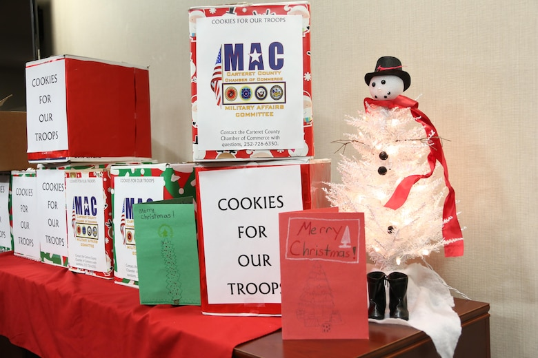Boxes of donated cookies and Christmas cards are placed on a table during an annual cookie drop aboard Marine Corps Air Station Cherry Point, N.C., Dec. 22, 2016. The Carteret County's Chamber of Commerce's Military Affairs Committee donated 26 boxes of cookies to Marines and Sailors on duty aboard the air station. Elementary school students from Carteret County added homemade Christmas cards in the boxes to wish the service members a happy holiday season. (U.S. Marine Corps photo by Cpl. Jason Jimenez/ Released)