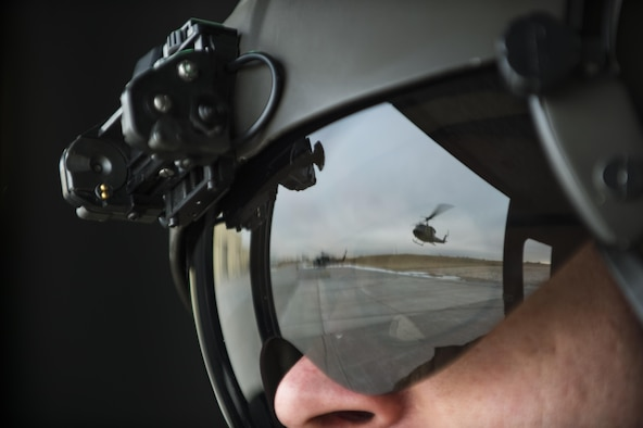 Master Sgt. Chris Baker, 37th Helicopter flight engineer, looks on as a 37th HS UH-1N Huey takes off the helipad at F.E. Warren Air Force Base, Wyo., Dec. 16, 2016. That days' training consisted of search and rescue tactics and practicing emergency security response at a launch facility with the 790th Missile Security Forces Squadron. (U.S. Air Force photo by Staff Sgt. Christopher Ruano)