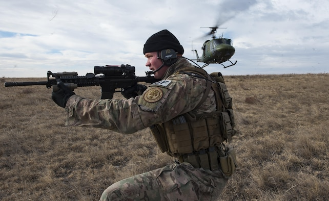 Senior Airman Joshua Hudson, 790th Missile Security Forces Squadron tactical response force assaulter, secures a landing site during emergency security response training with the 37th Helicopter Squadron at a launch facility in the F.E. Warren Air Force Base, Wyo., missile complex, Dec. 16, 2016. The 37th HS supports the mission of the 90th Missile Wing by providing aerial surveillance and emergency deployments of security response forces throughout the base and missile field. (U.S. Air Force photo by Staff Sgt. Christopher Ruano)