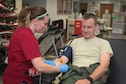 161214-Z-EU280-2020: U.S. Air Force Lt. Col. Eric Dolan, a C-130 Hercules navigator with the 182nd Operations Support Squadron, Illinois Air National Guard, gets sterilized with iodine before donating blood at an American Red Cross blood drive at the 182nd Airlift Wing in Peoria, Ill., Dec. 14, 2016. The wing's company grade officers council hosted the event as a way for unit members to give back to their communities. (U.S. Air National Guard photo by Tech. Sgt. Lealan Buehrer)