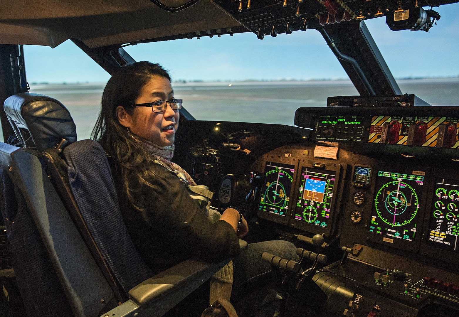 Aryn Lockhart, 17th Training Wing graphic artist, sits in the pilot seat  of a C-5 simulator at the 733rd Training Squadron Dec. 19, 2016 at Joint Base San Antonio-Lackland, Texas. Lockhart was an infant aboard the ill-fated C-5 flight out of Vietnam on April 4, 1975 during Operation Babylift. (U.S. Air Force photo by Benjamin Faske)