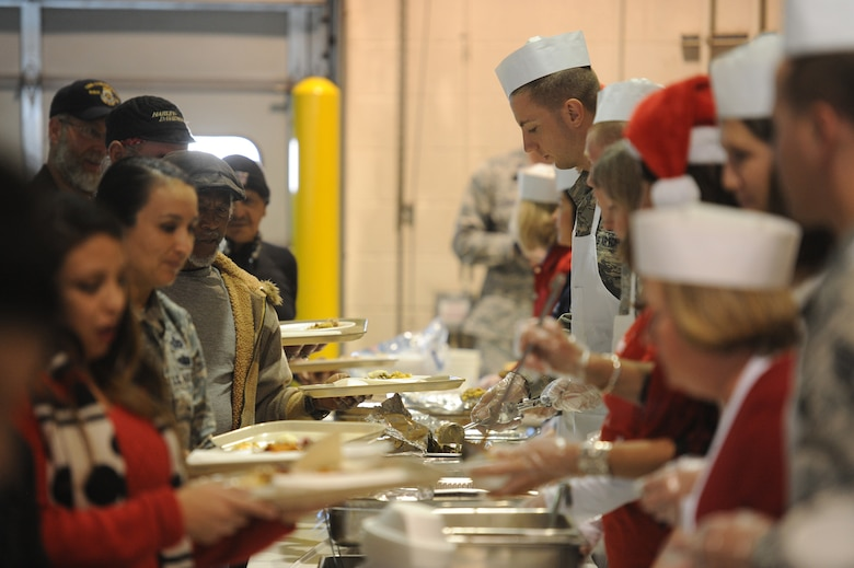 Volunteers served more than 1,700 members of the community full holiday meals, with turkey, enchiladas, posole, mashed potatoes and desserts. at Operation Holiday Cheer, one of Kirtland's biggest charitable events of the year. The event, hosted annually by the Kirtland Air Force Base Fire Department, delivered more than 800 new, high-quality toys to children Dec. 14.