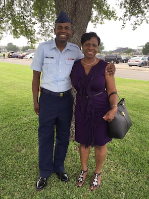 Airman Alfred Grannell, 460th Space Wing Comptroller Squadron budget analyst on Buckley Air Force Base, Colo., poses for a photo with his aunt, Winifred Brown of Waterbury, Connecticut, after graduating Basic Military Training April 29, 2016, on Joint Base San Antonio-Lackland, Texas. BMT is an eight-and-a-half-week program of physical and mental training required in order for an individual to become an Airman in the United States Air Force.