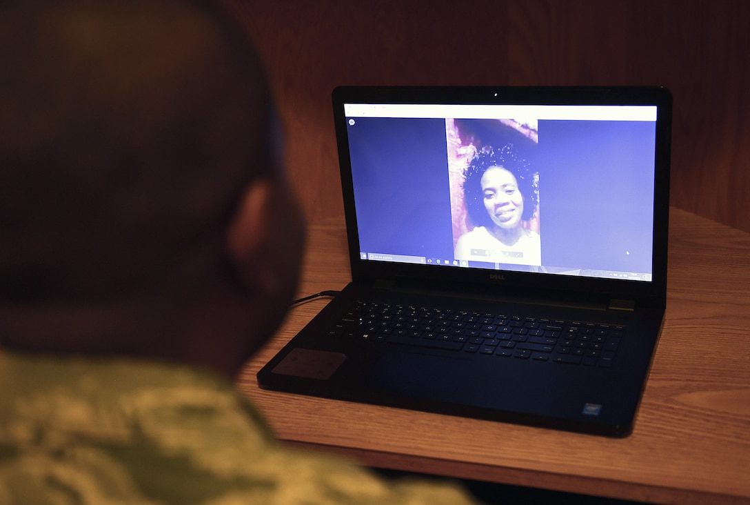 Airman Alfred Grannell, 460th Space Wing Comptroller Squadron budget analyst, talks with his fiancée, Debbie Coghiel of Portmore, Jamaica, through Facebook video chat Dec. 21, 2016, on Buckley Air Force Base, Colo. Grannell uses video chat to communicate with his family and fiancée in his native country of Jamaica. (U.S. Air Force photo by Airman Jacob Deatherage)