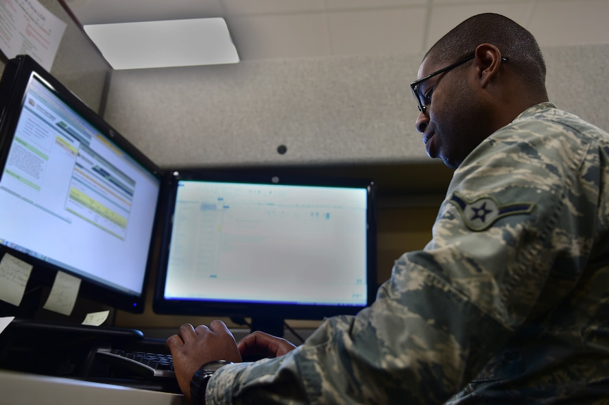 Airman Alfred Grannell, 460th Space Wing Comptroller Squadron budget analyst, works his job Dec. 22, 2016, in the financial management analysis office on Buckley Air Force Base, Colo. The FMA office handles budgeting for different units on base. (U.S. Air Force photo by Airman Jacob Deatherage)
