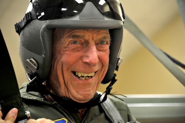 "Retired Capt. Jerry Yellin, a former U.S. Army Air Corps fighter pilot, dangles in the parachute trainer during pre-flight orientation training Dec. 16, 2016, at Laughlin Air Force Base, Texas.  Now 92, he enlisted two months after the bombing of Hickam Air Field and Pearl Harbor, Hawaii, on his 18th birthday in February of 1942. After graduating from Luke Air Field as a fighter pilot in August 1943, he spent the remainder of the war flying P-40, P-47 Thunderbolt and P-51 Mustang combat missions in the Pacific with the 78th Fighter Squadron, known as the ""Bushmasters."" (U.S. Air Force photo/Tech. Sgt. Mike Meares)"