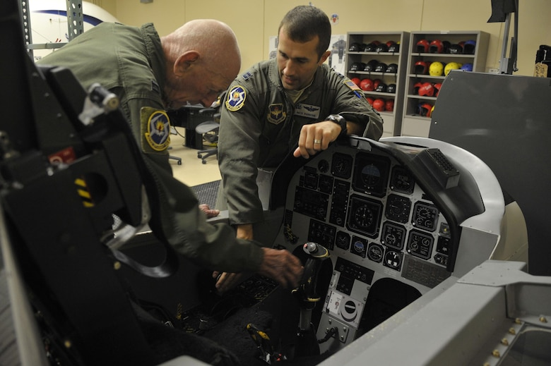 "Capt. Steven Parsons, 47th Student Squadron T-6A Texan II instructor pilot, shows the T-6 trainer to retired Capt. Jerry Yellin, a former World War II U.S. Army Air Corps fighter pilot, during initial training for an orientation flight Dec. 16, 2016. After graduating from Luke Air Field as a fighter pilot in August of 1943, he spent the remainder of the war flying P-40, P- 47 Thunderbolt and P-51 Mustang combat missions in the Pacific with the 78th Fighter Squadron, known as the ""Bushmasters."" (U.S. Air Force photo/Tech. Sgt. Mike Meares)"