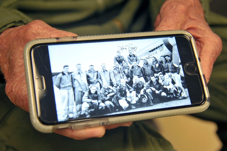 "Capt. Jerry Yellin, a former U.S. Army Air Corps fighter pilot, shows a photo taken in 1944 toward the end of World War II, of the 78th Fighter Squadron ""Bushmasters,"" during his visit to Laughlin Air Force Base, Texas, Dec. 14, 2016. Yellin enlisted two months after the bombing of Hickam Air Field and Pearl Harbor, Hawaii, on his 18th birthday. He was a part of the squadron who flew the final combat mission in the Pacific at the conclusion of World War II. (U.S. Air Force photo/Tech. Sgt. Mike Meares)"