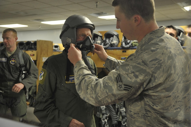 "Capt. Jerry Yellin, a former U.S. Army Air Corps fighter pilot, is fitted for a helmet and face mask by Senior Airman Todd Brackenbury, 47th Operations Support Squadron, in preparation for an orientation flight at Laughlin Air Force Base, Texas, Dec. 16, 2016. Yellin, 92, enlisted two months after the bombing of Hickam Air Field and Pearl Harbor, Hawaii, on his 18th birthday. After graduating from Luke Air Field as a fighter pilot in August of 1943, he spent the remainder of the war flying P-40, P- 47 Thunderbolt and P-51 Mustang combat missions in the Pacific with the 78th Fighter Squadron, known as the ""Bushmasters,"" signified by the open-mouth snake's head worn on their patches. (U.S. Air Force photo/Tech. Sgt. Mike Meares)"