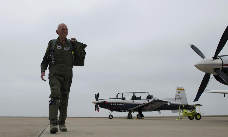 Jerry Yellin, author and retired U.S. Army Air Corps Captain, walks on the flight line after an orientation flight on Laughlin Air Force Base, Texas, Dec. 15, 2016. Yellin, participated in the first land-based fighter mission over Japan on April 7, 1945, and flew the final combat mission of World War II on the day the war ended. (U.S. Air Force photo/Senior Airman Ariel D. Partlow)