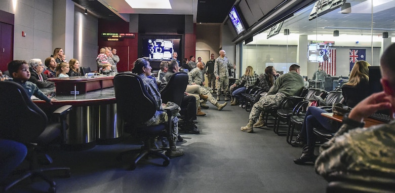 The 460th Operations Group pulls back the curtain to show attendees of Team Buckley Spouse and Family Day operators working and flying the satellites controlled inside the Mission Control Center on Buckley AFB, Colo., Dec. 22, 2016. The event consisted of families given access to see the 460th Space Wing mission up close, with demonstrations from the operators, Defenders, and firefighters. (U.S. Air Force photo by Tech. Sgt. Nicholas Rau/Released)
