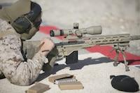 Cpl. Crystal Guerrero, Combat Center Shooting Team, reloads an M40A1 during the High Desert Regional Shooting Match at Marine Corps Air Ground Combat Center Twentynine Palms, Calif., Dec. 16, 2016.