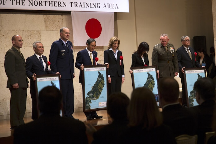 Representatives from the Government of Japan and the United States pose for photos at the conclusion of the Northern Training Area Land Return Ceremony Dec. 22 in Nago City, Okinawa, Japan. The ceremony signified the return of more than 9,852 acres of land from U.S. Forces Japan. The land, which was previously utilized by U.S. Forces Japan as part of the Northern Training Area, is the largest land return to date since 1972. During the ceremony, government representatives from the Japan and the United States gave remarks regarding the return of the land and the importance of the Japan-U.S. alliance.