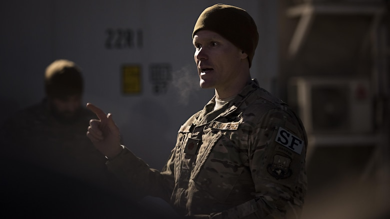 """Maj. Shawn Chamberlin, 455th Expeditionary Security Forces Squadron commander, speaks to Air Force Office of Special Investigations Expeditionary Detachment 2405 and 455th ESFS members before a """"Ruck March to Remember"""" fallen comrades Dec. 21, 2016 at Bagram Airfield, Afghanistan. The ruck march was held to honor Maj. Adrianna Vorderbruggen, Staff Sgt. Michael Cinco, Staff Sgt. Peter Taub, Staff Sgt. Chester McBride, Tech. Sgt. Joseph Lemm and Staff Sgt. Louis Bonacasa. (U.S. Air Force photo by Staff Sgt. Katherine Spessa)"""
