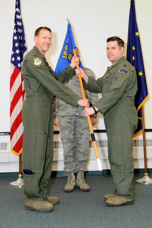 Lt. Col. Benjamin Doyle assumed command of the 168th Operations Support Squadron, Alaska Air National Guard, December 22, 2016 during a ceremony held at the unit's operations group theater on Eielson AFB, Alaska. Doyle assumes command of the 34-Airmen squadron that collectively plays a role in almost every facet of the Interior-Alaska based flying squadron's mission. (U.S. Air National Guard photo by Senior Master Sgt. Paul Mann/Released)