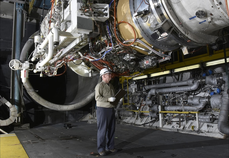 Neil Aukeman, AEDC outside machinist, prepares the General Electric Passport 20 engine, which powers the Bombardier Global 7000 and 8000 business jets, for testing in an engine test cell at AEDC. (U.S. Air Force photo/Rick Goodfriend)