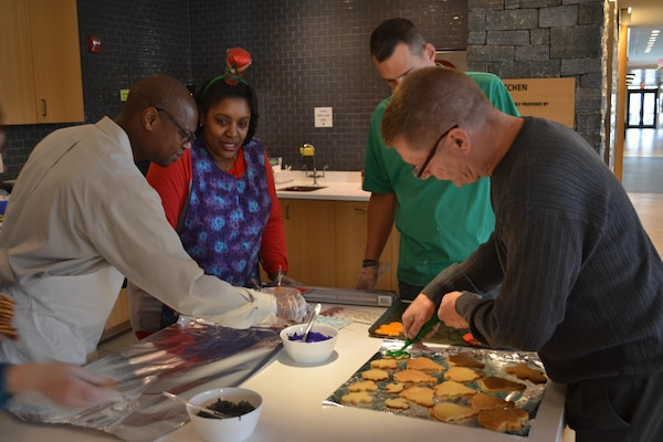 From left: George Gray, Dorothy Russell, Mike Johnson and Bill Farmer put the finishing touches on cookies to be distributed to  Fort Belvoir installation staff on Dec. 24.