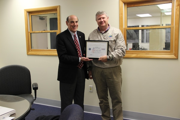 Paul Finn, Eastern Distribution Center operations manager at DLA Distribution Susquehanna, Pa., is presented the Employer Support of the Guard and Reserve Patriotic Employer award by James Astor, chair of South Central Pennsylvania ESGR.