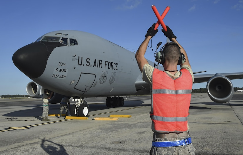 A crew chief assigned to Joint Base Charleston marshals one of MacDill Air Force Base's (AFB) KC-135 Stratotanker at Joint Base Charleston, South Carolina, Oct. 27. Four steady-state KC-135 Stratotankers and 90 Airmen operated out of JB Charleston during MacDill AFB's runway reconstruction project. The aircraft and personnel returned to MacDill AFB on Dec. 19 and 20.