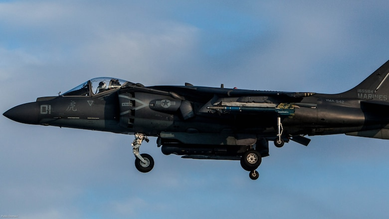 A U.S. Marine Corps AV-8B Harrier with Marine Attack Squadron 542 prepares to land on the runway during the Aviation Relocation Training Program at Chitose Air Base, Japan, Dec. 14, 2016. VMA-542 is conducting training at Chitose Air Base in an effort to increase operational readiness between the U.S. Marine Corps and the Japan Air Self Defense Force, improve interoperability and reduce noise concerns of aviation training on local communities by disseminating training locations throughout Japan.
