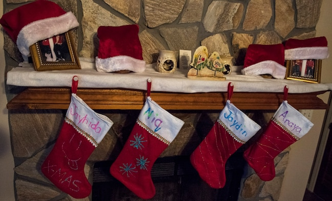 Stockings hang above a fireplace Dec. 23, 2016, in Valdosta, Ga. In the spirit of Christmas, the family of Airman 1st Class Janiqua P. Robinson, 23d Wing photojournalist, decorated their stockings and hung them by the chimney with care, hoping that Santa Claus would soon be there. (U.S. Air Force photo by Airman 1st Class Janiqua P. Robinson)
