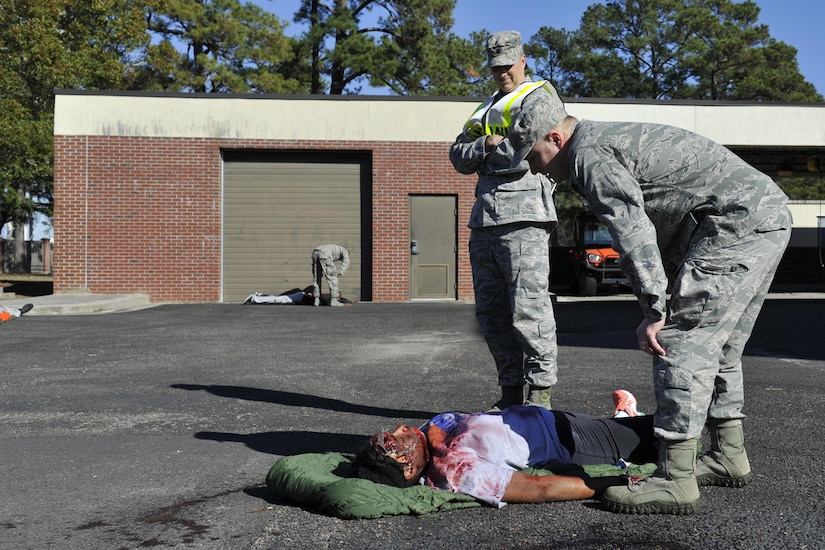 Airmen from the 628th Medical Group participate in a mass casualty exercise at Joint Base Charleston, South Carolina, Dec. 21, 2016. The exercise evaluated how medical personnel would respond to an incident on base needing triage, medical care and patient transportation.