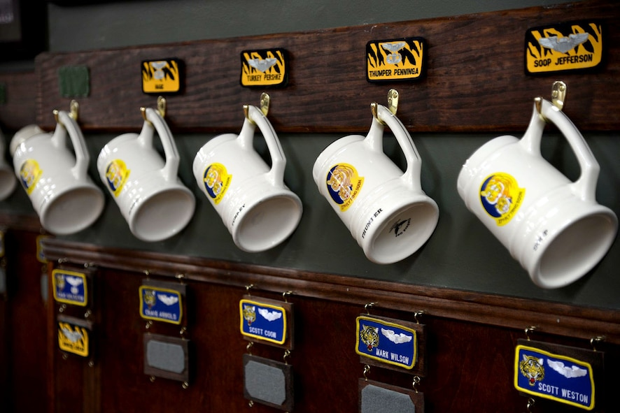 The heritage room for the 37th Flying Training Squadron holds many items and pictures of previous incarnations of the 37th FTS at Columbus Air Force Base, Mississippi. Mugs for permanent party personnel are hung along its walls April 12, 2016. (U.S. Air Force photo by Airman 1st Class John Day)