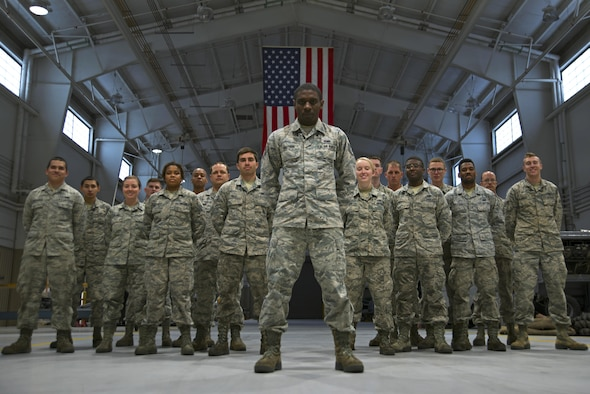 U.S. Air Force Staff Sgt. Preston Moten, 20th Equipment Maintenance Squadron aerospace ground equipment schedule and training monitor, stands in front of 20th EMS Airmen at Shaw Air Force Base, S.C., Dec. 9, 2016. Moten had retained negative habits from his life prior to the Air Force that jeopardized his career and the safety of his fellow Airmen, but used the support and guidance offered by his team members to break those habits and become more resilient. (U.S. Air Force photo by Airman 1st Class Kathryn R.C. Reaves)