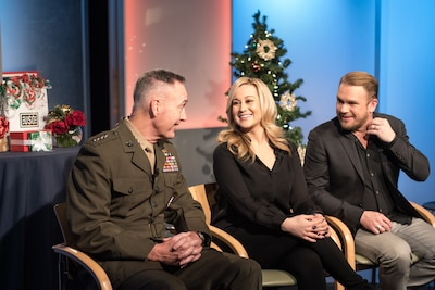 Marine Corps Gen. Joe Dunford, chairman of the Joint Chiefs of Staff, country music artist Kellie Pickler, and Pickler's husband, country music songwriter Kyle Jacobs, speak between television and radio interviews at the National Press Club in Washington about their USO Tour to the Middle East to visit troops for the holidays, Dec. 23, 2016. DoD photo by Army Sgt. James K. McCann