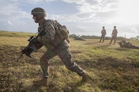 Cpl. Logan Jenkins, an infantry assault Marine with Battalion Landing Team, 2nd Battalion, 5th Marine Regiment, 31st Marine Expeditionary Unit, rushes to his firing position during live-fire and maneuver drills at Camp Hansen, Okinawa, Japan, Dec. 22, 2016. As the Marine Corps' only continuously forward-deployed unit, the 31st MEU air-ground-logistics team provides a flexible force, ready to perform a wide range of military operations, from limited combat to humanitarian assistance operations, through the Indo-Asia-Pacific region.