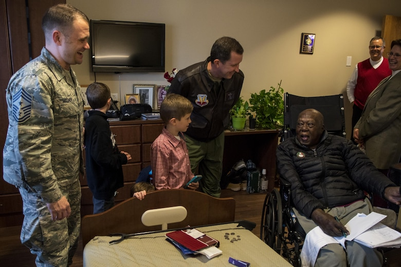 Chief Master Sgt. Shane Wagner (left), 4th Fighter Wing command chief, and Col. Christopher Sage (center), 4th FW commander, laugh with Eugene Shaw, U.S. Army veteran and resident of the North Carolina State Veterans Home, Dec. 24, 2016, in Kinston, North Carolina. Sage and Wagner and more than 45 volunteers visited with over 90 veterans and passed out goody bags and holidays cards. (U.S. Air Force photo by Airman Shawna L. Keyes)