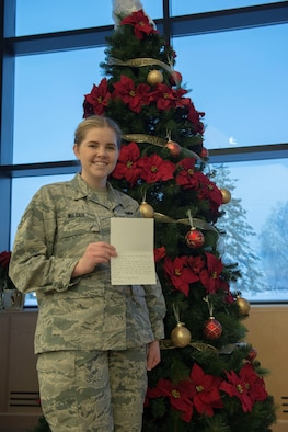 U.S. Air Force Senior Airman Harleigh Wilcox, a 354th Operations Group administration journeyman, stands with a letter of appreciation from the Fairbanks Community Food Bank, Dec. 16, 2016, at Eielson Air Force Base, Alaska. Wilcox donated her vehicle to the food bank, which allowed a local member to get back on his feet. (U.S. Air Force photo by Staff Sgt. Ashley Nicole Taylor)