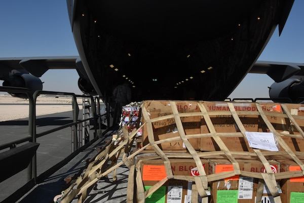 U.S. Air Force Airmen with the 8th Expeditionary Air Mobility Squadron load cargo onto a C-17 Globemaster III at Al Udeid Air Base, Qatar, Dec. 12, 2016. The 8th EAMS expertise in transportation and logistics enable them to inspect, temporarily store and load cargo such as munitions, blood, special operations cargo, hazardous materials, vehicles and medical supplies. (U.S. Air Force photo by Senior Airman Cynthia A. Innocenti)