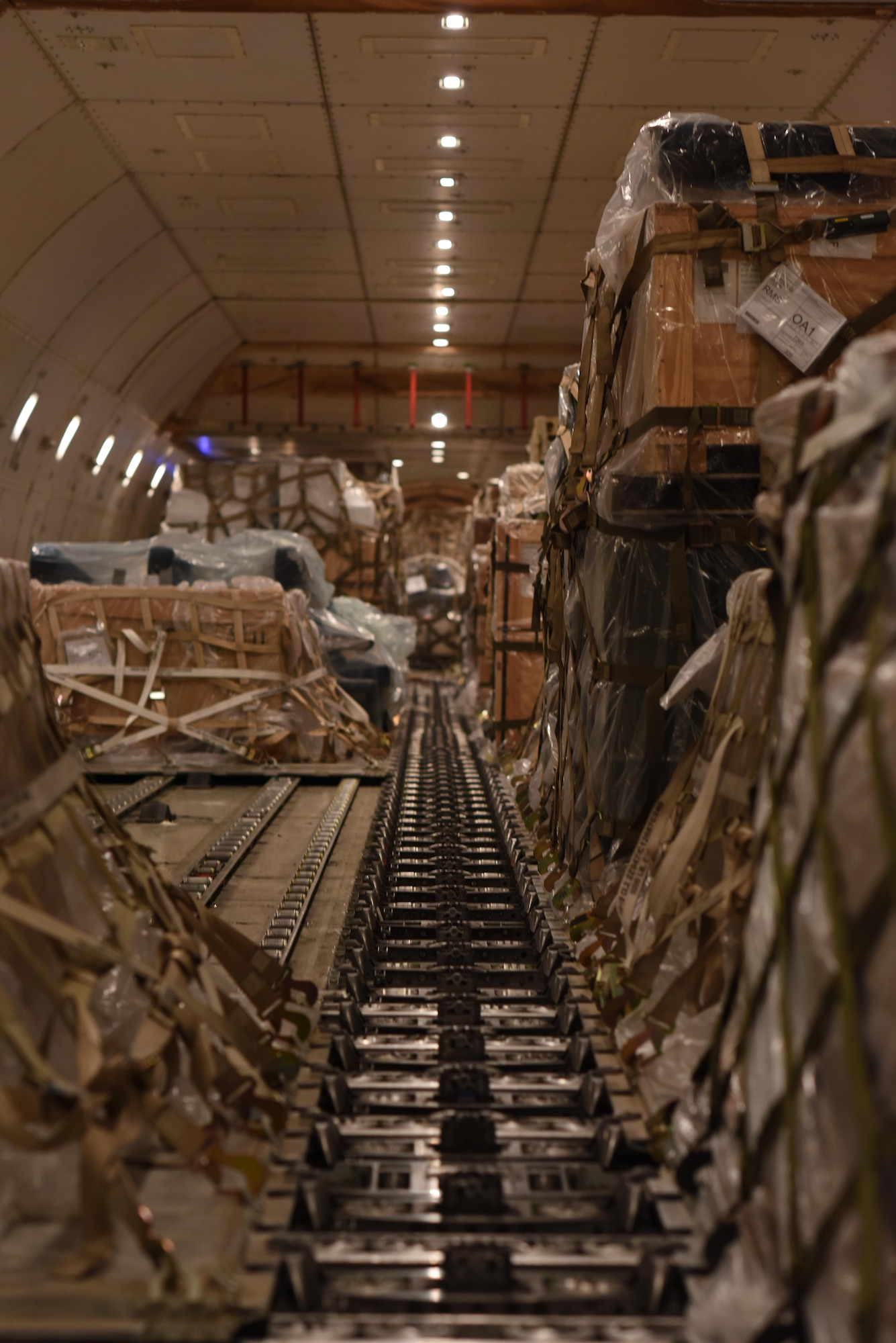 Cargo waits as Airmen with the 8th Expeditionary Air Mobility Squadron prepare to offload it at Al Udeid Air Base, Qatar, Dec. 24, 2016. The 8th EAMS Airmen work round the clock to ensure cargo is loaded and offloaded in an expedient manner.  (U.S. Air Force photo by Senior Airman Cynthia A. Innocenti)